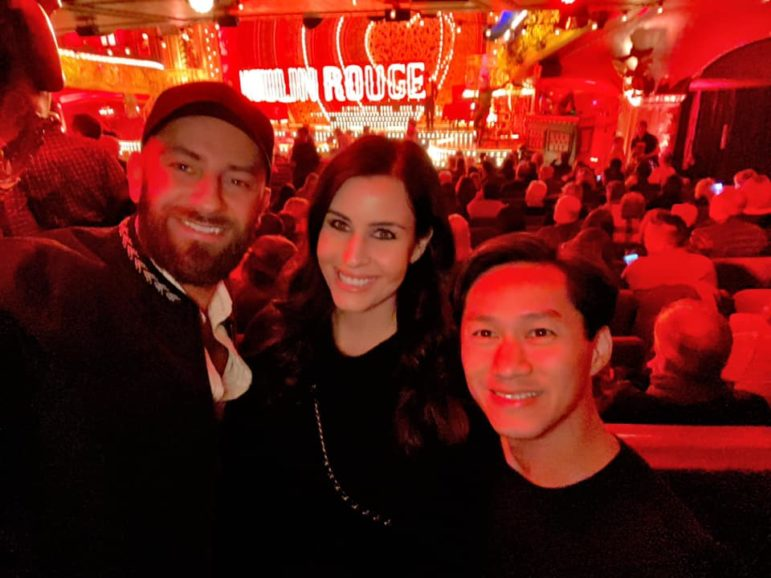 "Dr. Quan Tran, right, his wife, Evan Elizabeth, and his brother-in-law, Seth Duhy, attend a Nov. 9, 2019, performance of ""Moulin Rouge"" in Manhattan. Source: Facebook"